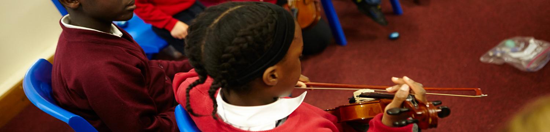 Violin header_Trinity School.png